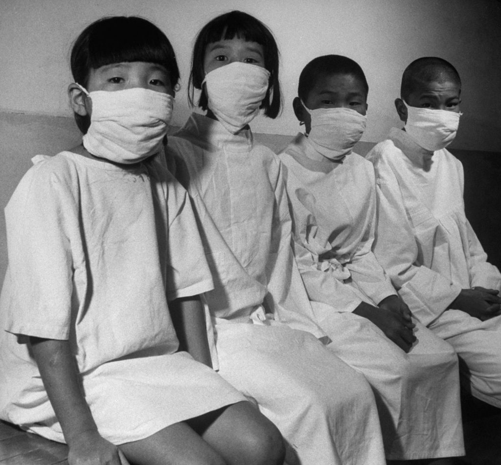 Hiroshima's children patiently wait their turn for a complete and detailed physical examination in ABCC's [Atom Bomb Casualty Commission] temporary laboratory clinic.