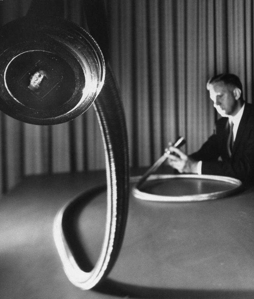 Demonstrating early fiber optics, 1960.