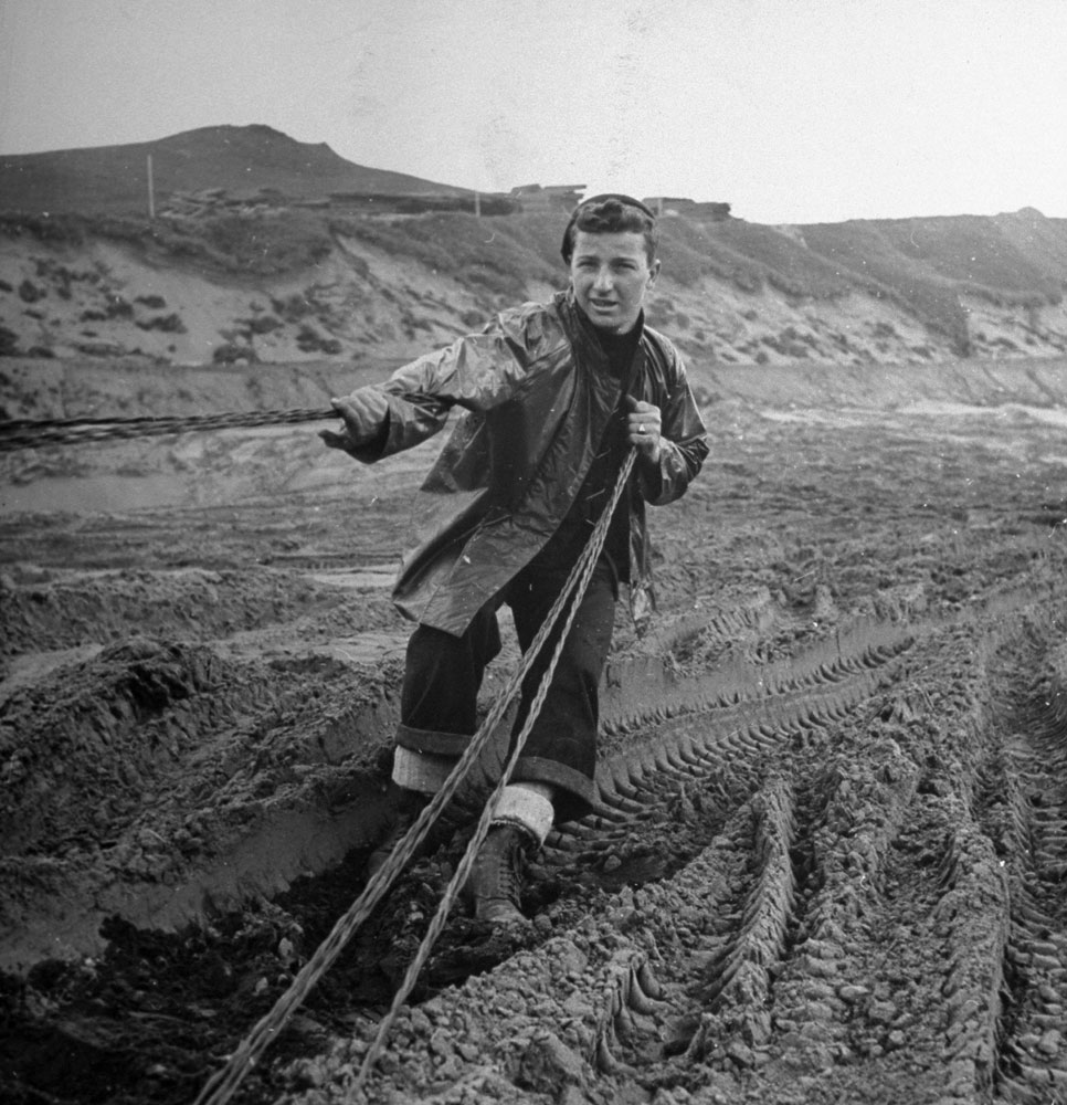 A Seabee (of the U.S. Navy's Construction Battalion) strings wire for communications on the island of Adak, Aleutian Campaign, Alaska, 1943.