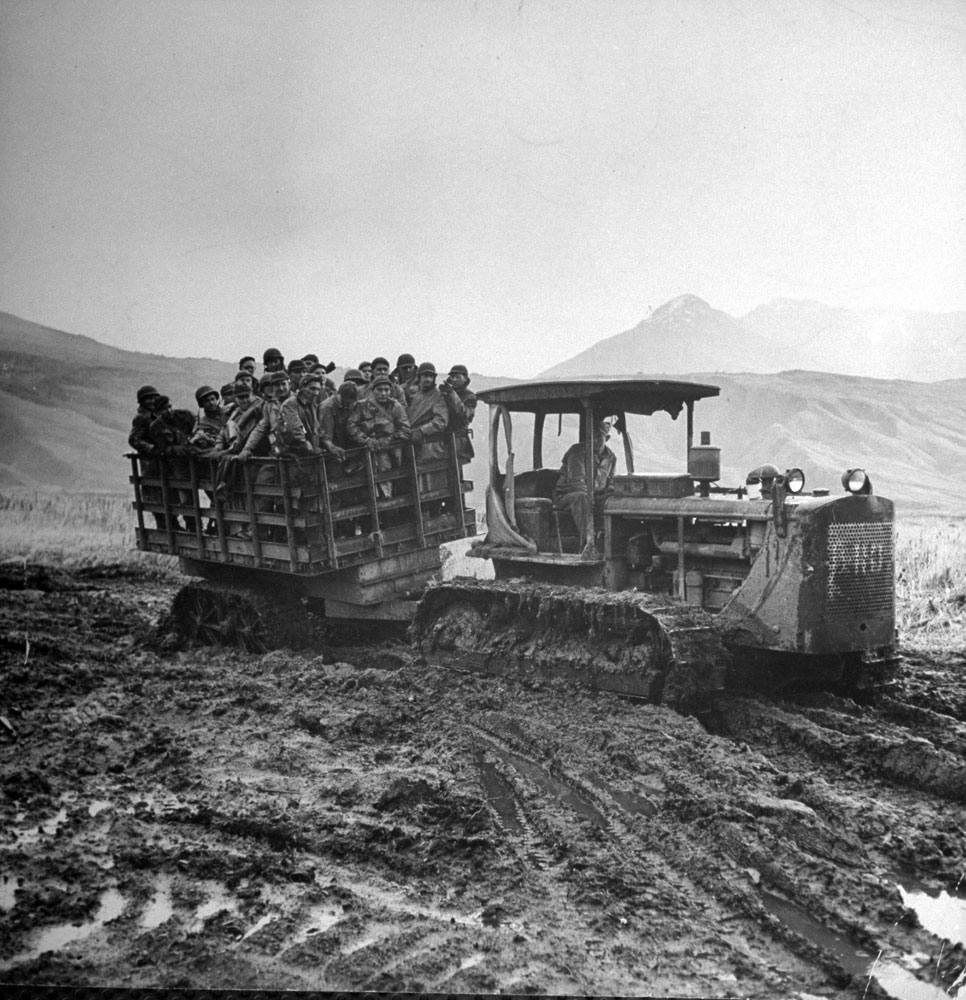 Troops are carted by tractor to the movies from an isolated camp in Massacre Vally, Attu Island, Aleutian Campaign, Alaska, 1943.
