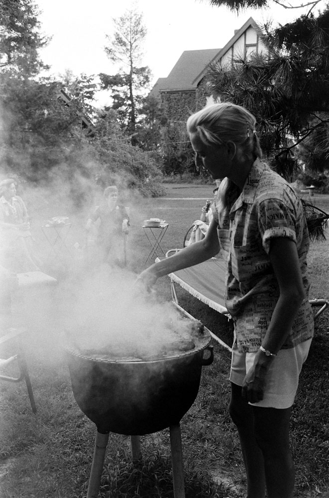 Jerrie Cobb keeps watch over the grill, 1959.