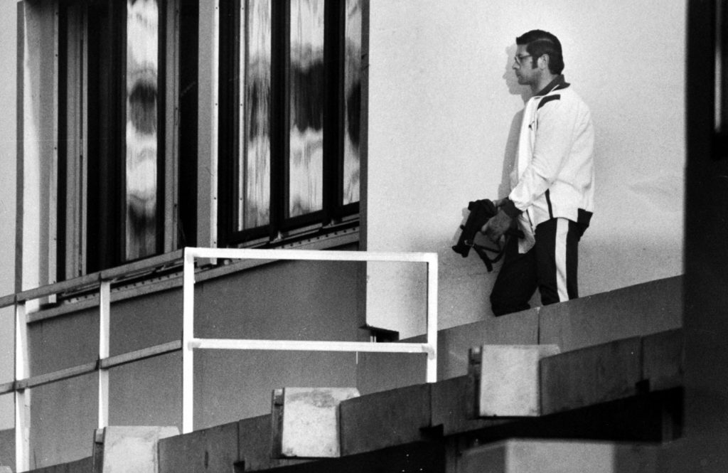 A German policeman leans against a wall outside an apartment where Israeli hostages are held, Munich, September 1972.