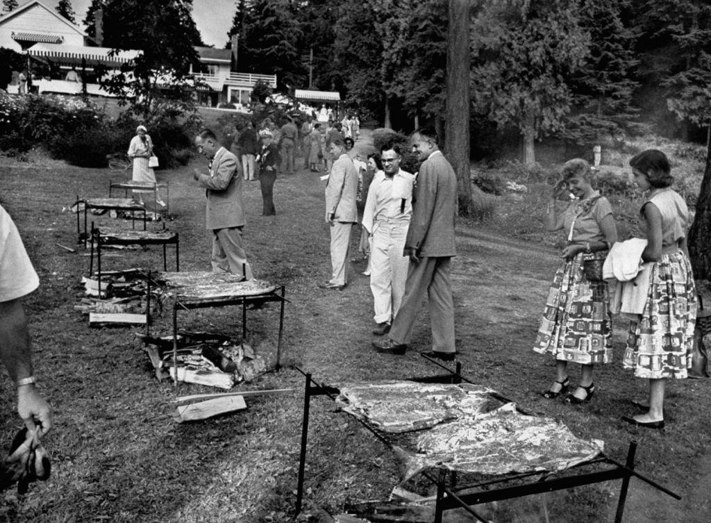 John D. Lodge (in the suit), the governor of Connecticut from 1951-55, surveys the scene at a salmon barbecue in 1953.