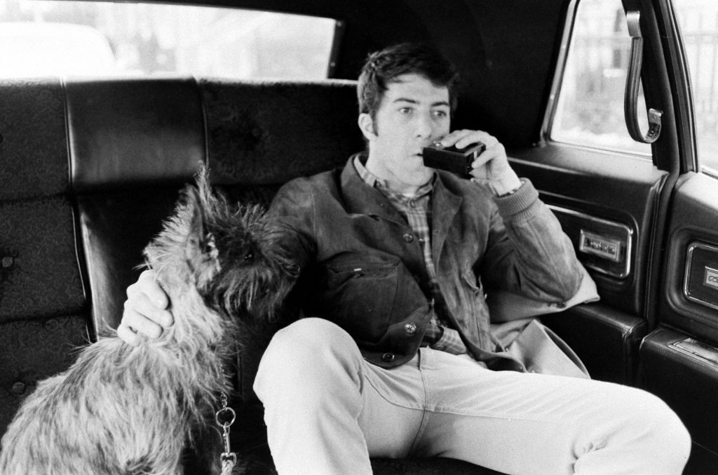 Dustin Hoffman on the way to the theater with his dog, Ratso, New York, 1969.