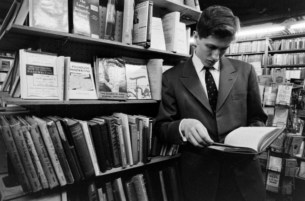 Bobby Fischer in a used bookstore, New York, 1962.