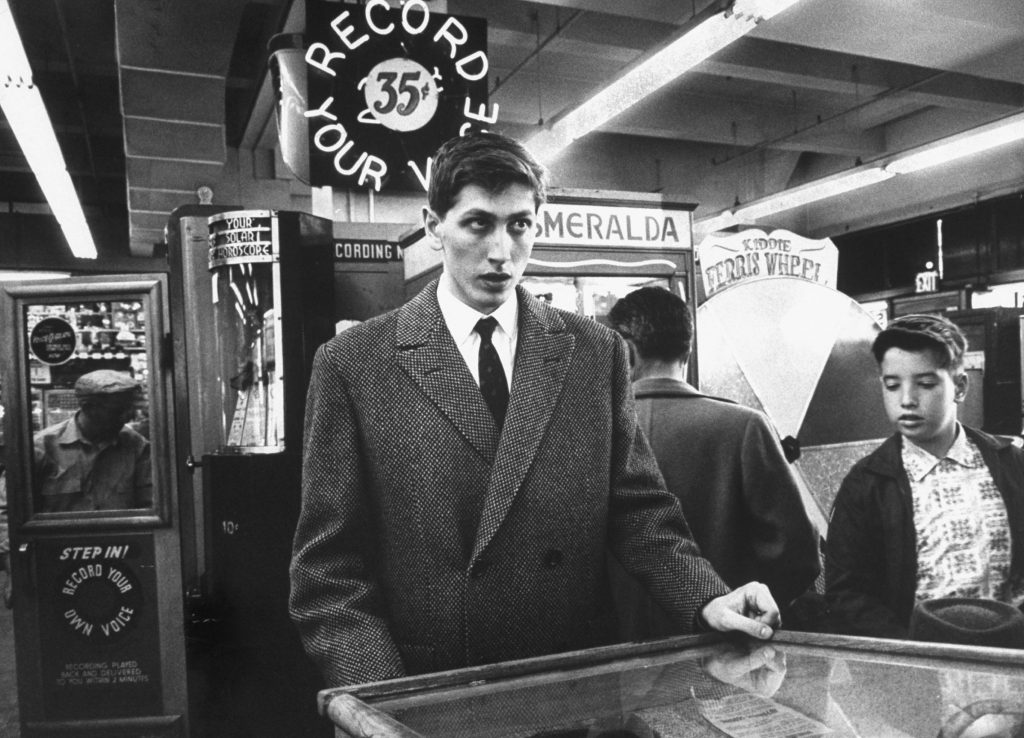 With chess problems spinning in his head by the millions, Bobby relaxes at a coin pinball machine.