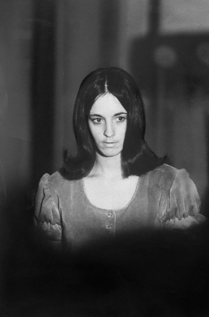 Manson Family member Susan Atkins, 21, emerges from a Los Angeles courtroom after grand jury testimony, December 1969.
