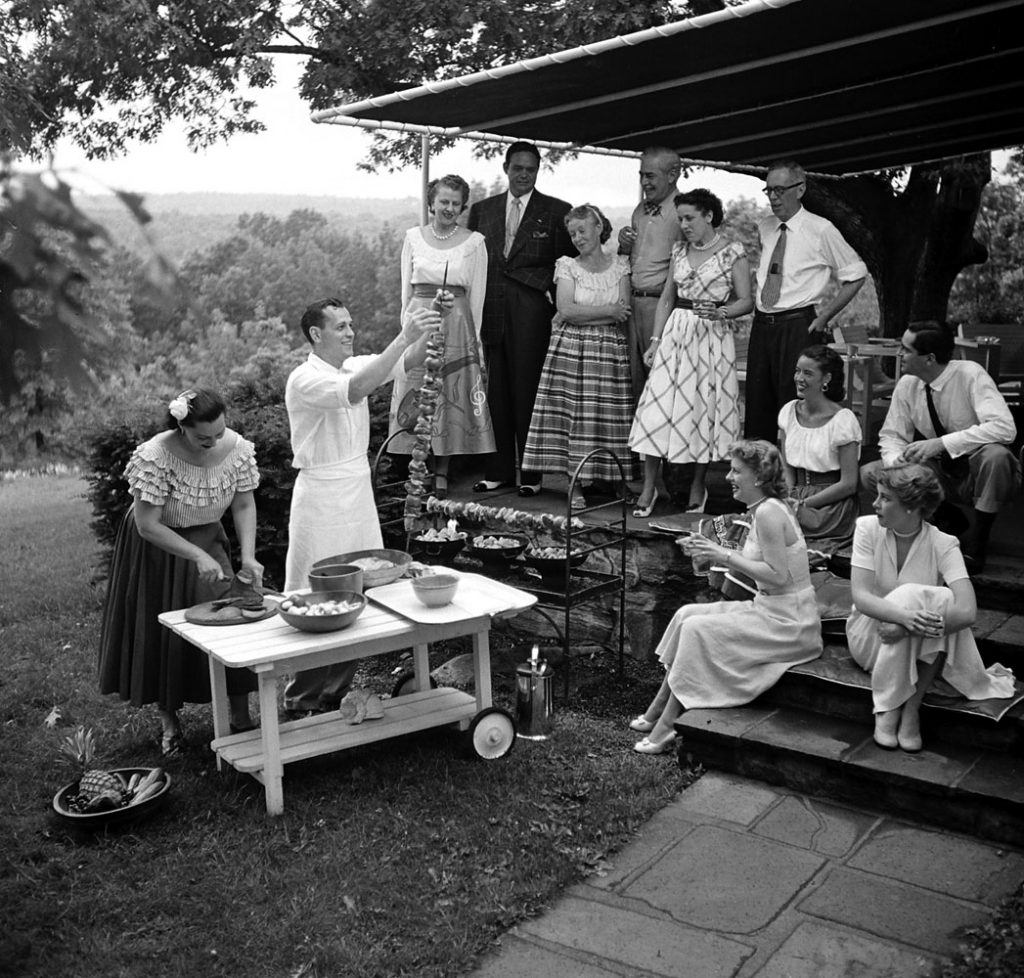 A gathering of well-dressed guests at a barbecue in Fairfield County, Conn., 1949.