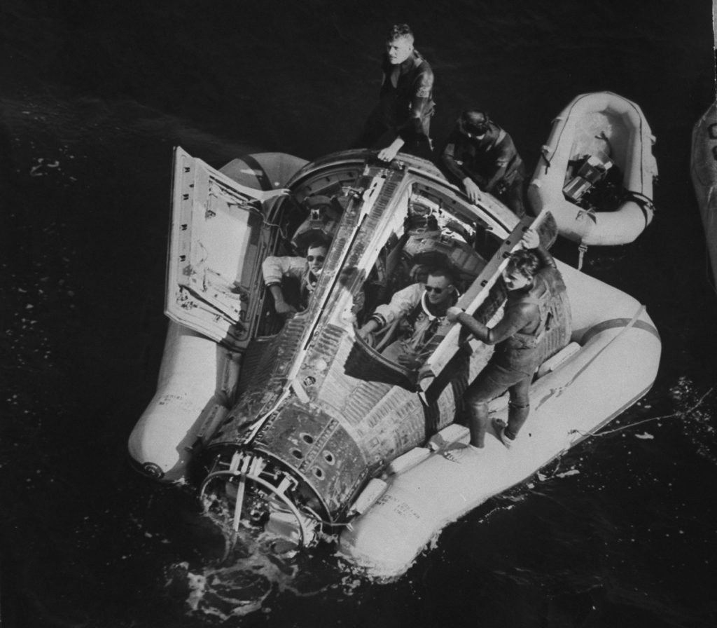 Gemini 8 astronauts Neil Armstrong and David Scott, floating in the Pacific after splashdown, 1966.