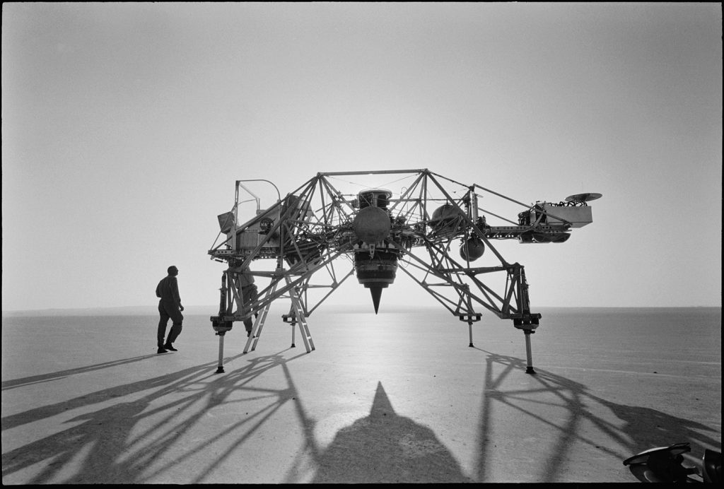 Neil Armstrong beside a prototype lunar lander module, Edwards Air Force Base, 1964.