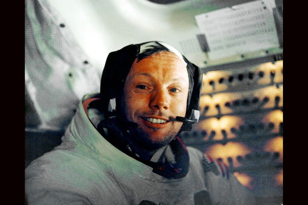 A tired but quietly jubilant Apollo 11 astronaut Neil Armstrong in space capsule after his historic walk on moon, July 1969.
