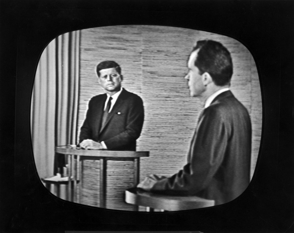 Presidential candidate Richard M. Nixon (right) speaks during a televised debate while opponent John F. Kennedy watches, 1960.