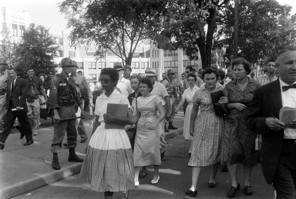 Hazel Bryant follows and jeers at Elizabeth Eckford as she walks from Little Rock's Central High after Arkansas National Guardsmen barred Eckford from school.