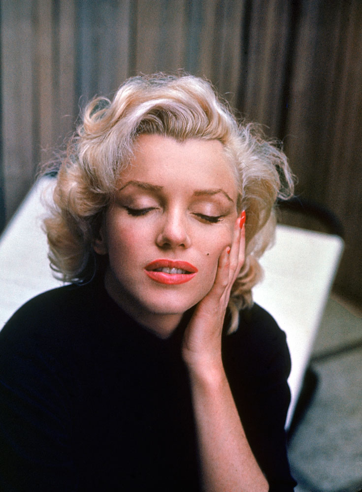 A serene Marilyn Monroe on the patio outside of her Los Angeles home, 1953.