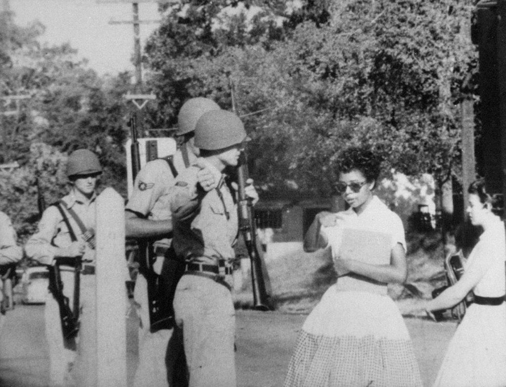Elizabeth Eckford, one of the Little Rock Nine, is waved off school grounds by Arkansas National Guardsmen, September, 1957.