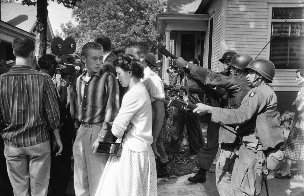 Segregationists rousted from an anti-integration protest, Little Rock, Arkansas, 1957.