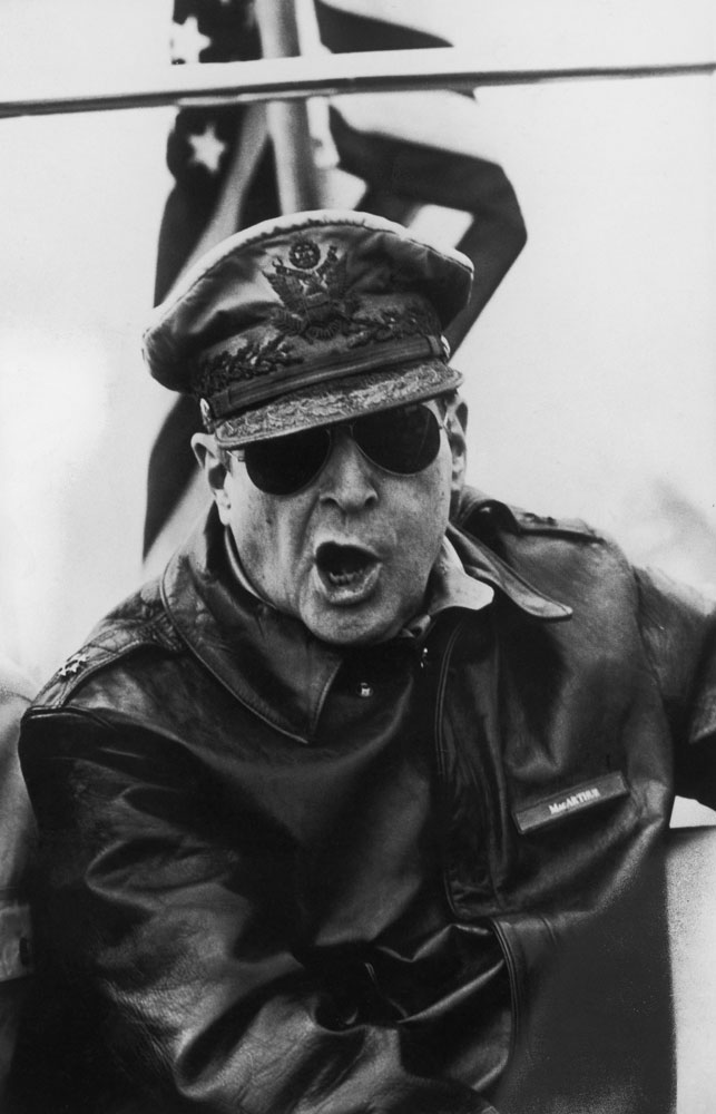 Gen. Douglas MacArthur roars orders from the bridge of the flagship USS Mount McKinley during an assault on the Inchon beachheads during the Korean War, 1950.