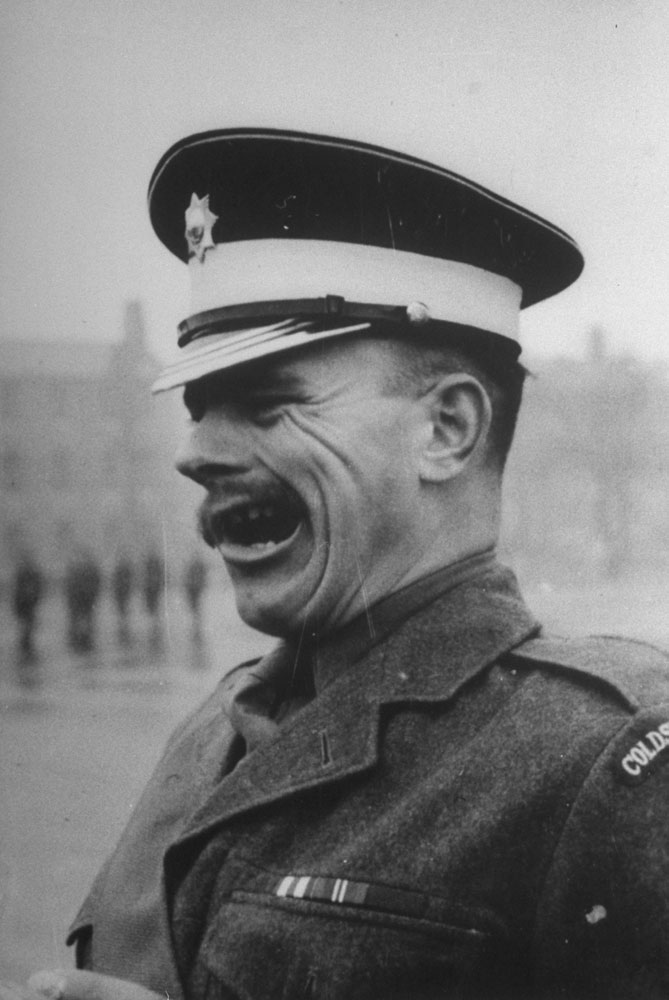 A tough sergeant bawls orders from the corner of his mouth, 1952.