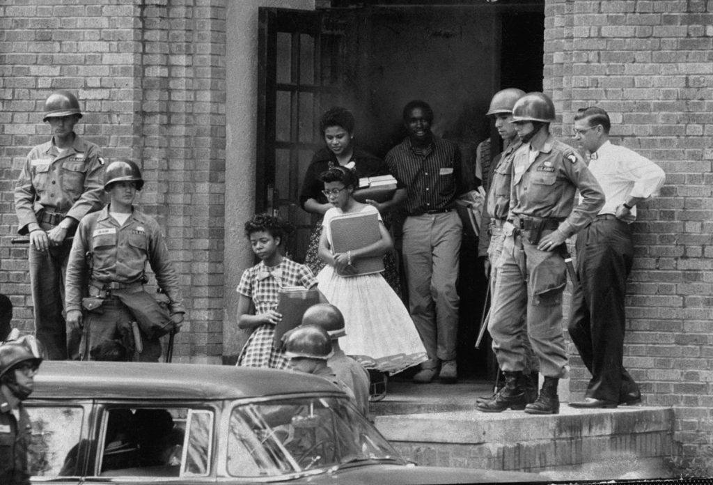 African-American students escorted by federal troops, Little Rock Central High School, 1957.