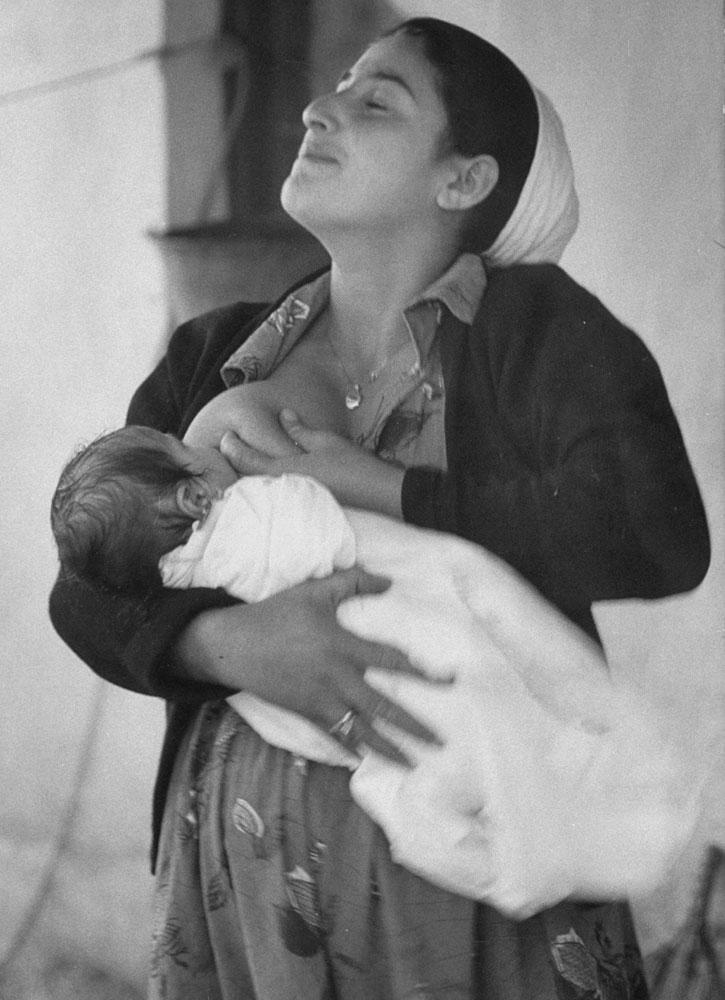 A mother nurses her child, Israel, 1960.