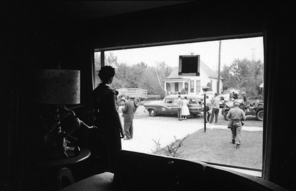 Civil Rights leader Daisy Bates gazes through her front window, watching the U.S. Army's 101st Airborne Division escort the Little Rock Nine from her home to begin their first full day of classes at the formerly all-white Central High School in Little Rock, Arkansas, 1957.