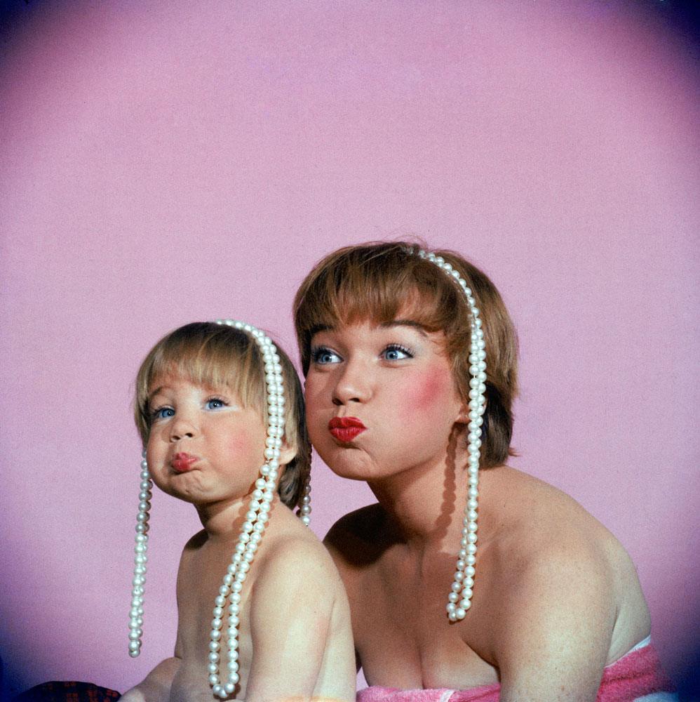 Shirley MacLaine and her daughter Sachi Parker playfully pout, 1959.