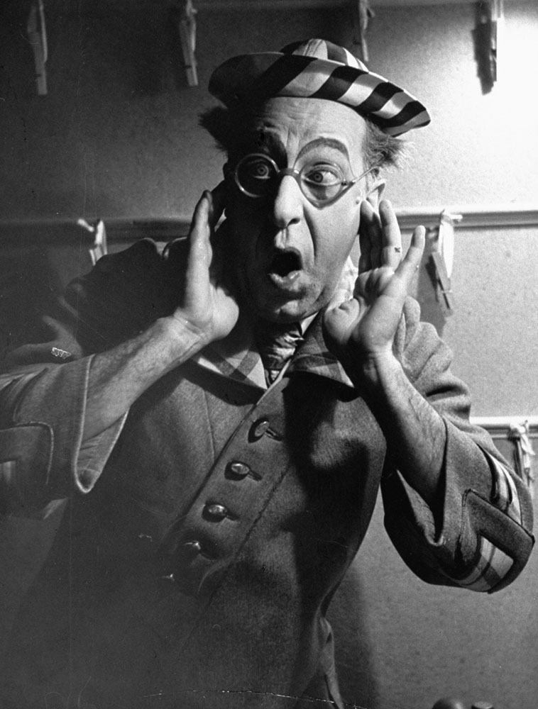 Comedian Ed Wynn looks horrified at the idea of killing worms in the Broadway show, Hooray for What!