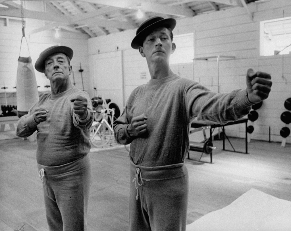 Buster Keaton and Donald O'Connor rehearse for a movie based on Keaton's life, 1956.