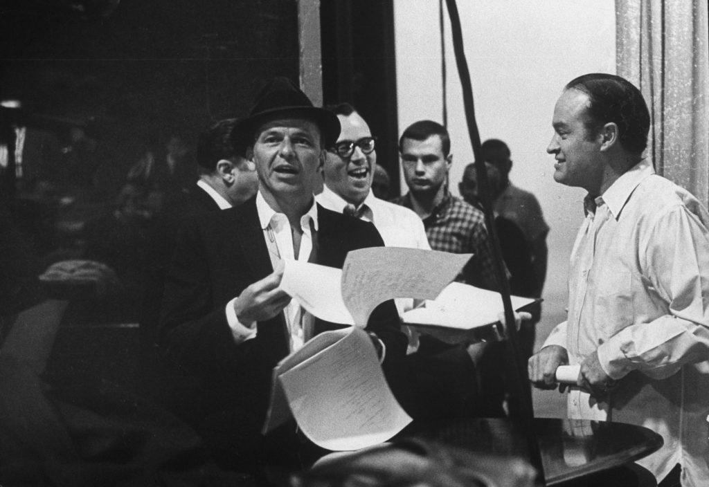 Bob Hope (right) and Frank Sinatra rehearse for The Bob Hope Show, 1962.