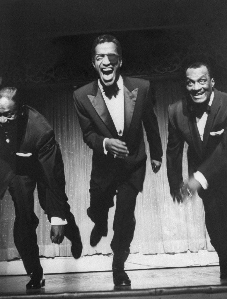 Sammy Davis Sr., Sammy Davis Jr. and Will Mastin on stage at Ciro's in West Hollywood, 1955.