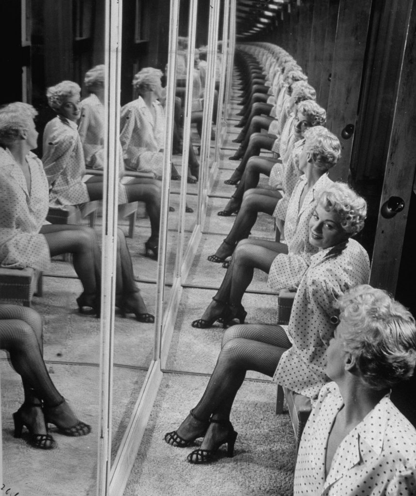 Shelley Winters in a booth with mirrors, 1949.