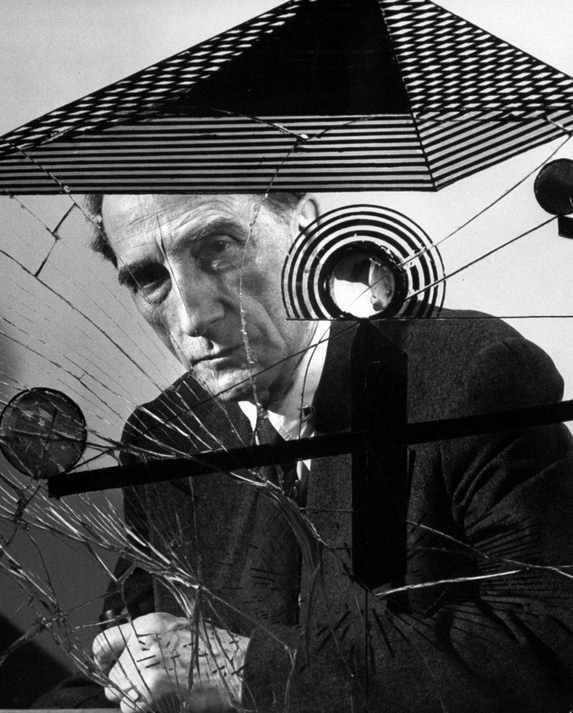 Marcel Duchamp with Dada artwork, 1953.