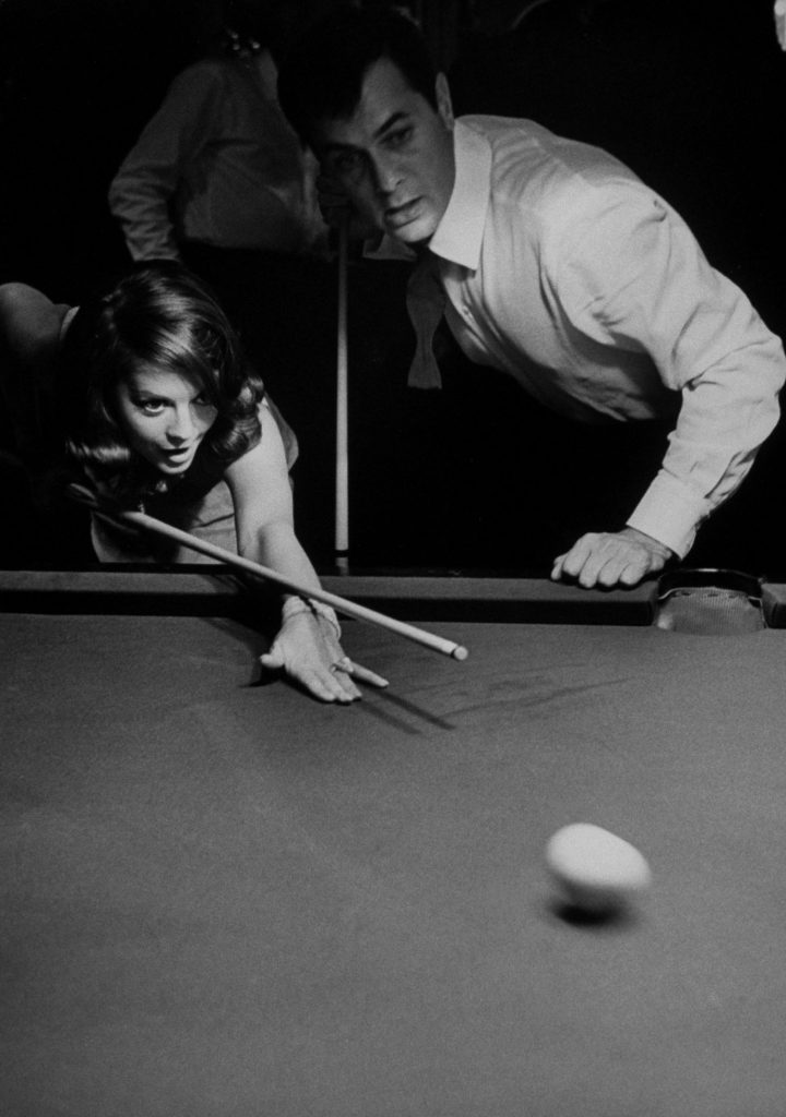 Natalie Wood learns to play billiards with Tony Curtis, 1963.