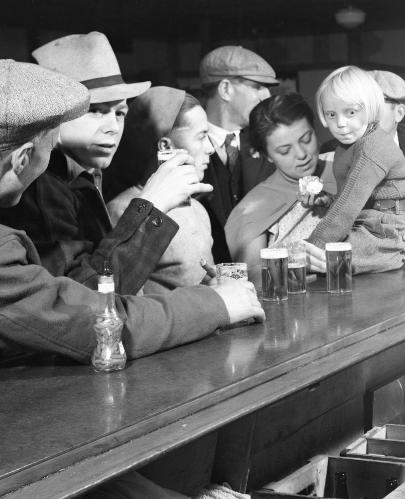 Drinking at the bar Finis, Montana, 1936.