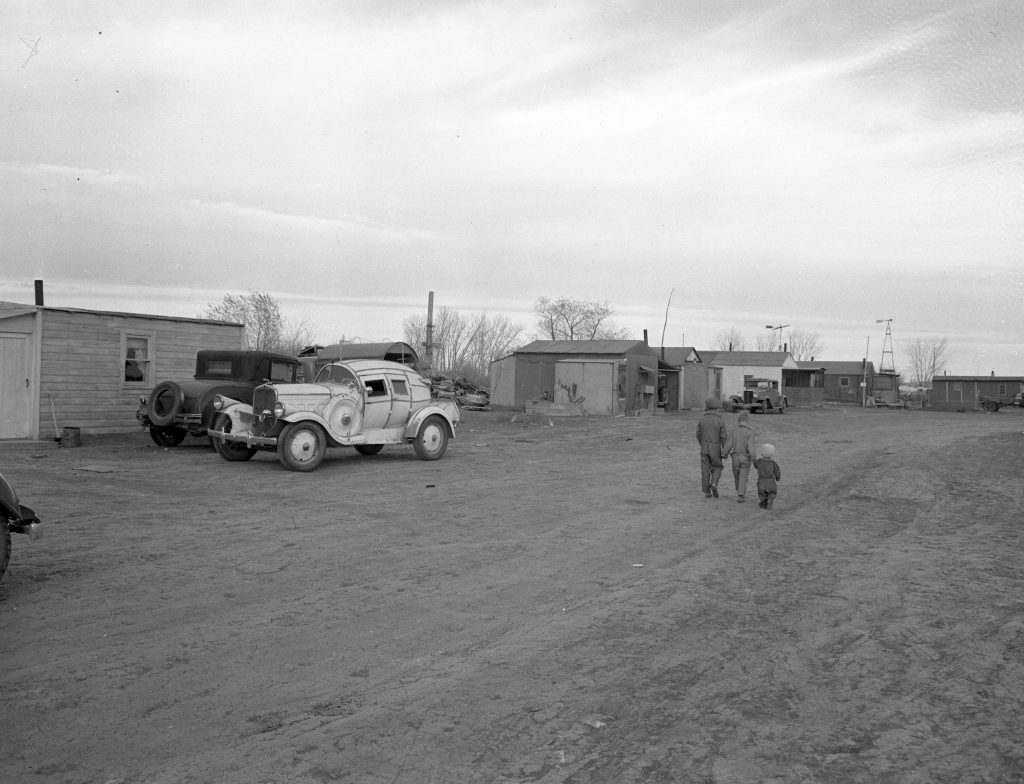 "Scene from one of the several ""frontier towns"" near the site of the Fort Peck Dam, Montana, 1936."