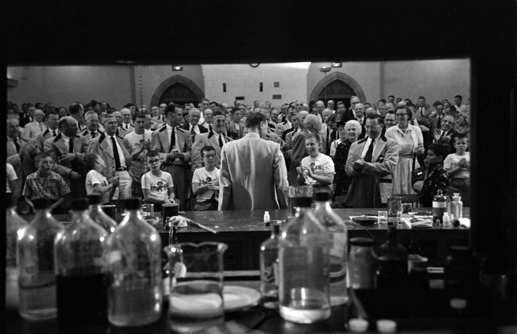The audience at one of Princeton professor Hubert Alyea's popular talks on the chemistry of the atomic bomb applauds Alyea in 1953.