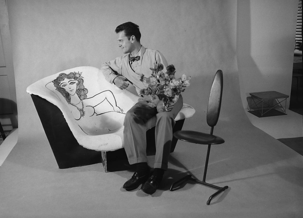 Charles Eames with a chair he designed and decorated, California, 1950.