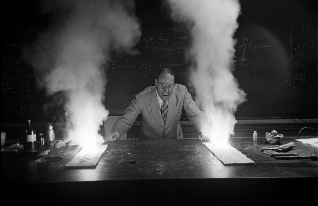Professor Hubert Alyea ignites a mixture of potassium chlorate and sugar during his talk on the chemistry of the atomic bomb, Princeton, 1953.