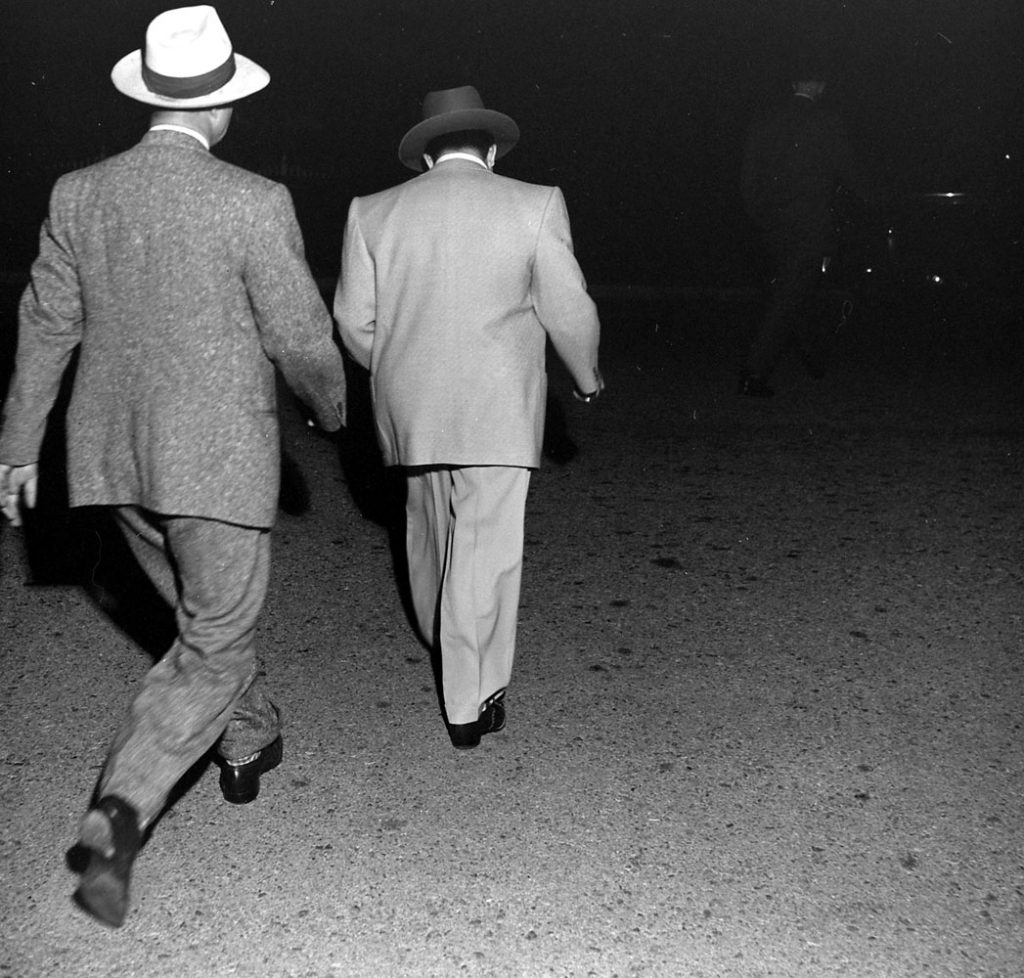 Mickey Cohen hauled in by the cops, Los Angeles, 1949.