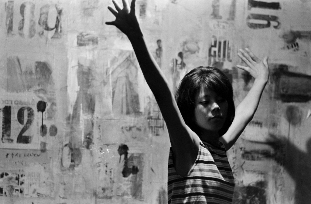 Seventeen-year-old Yoko, with arms outstretched, Japan, 1964.