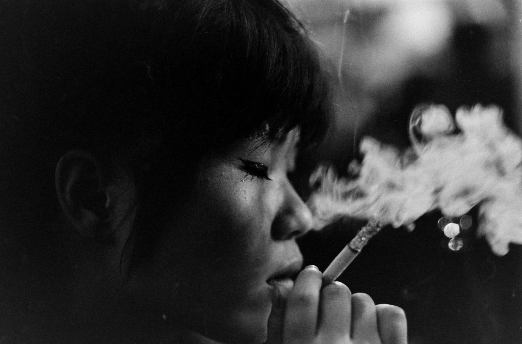 Kako, languid from sleeping pills, is lost in a world of her own in a jazz club in Tokyo, 1964.
