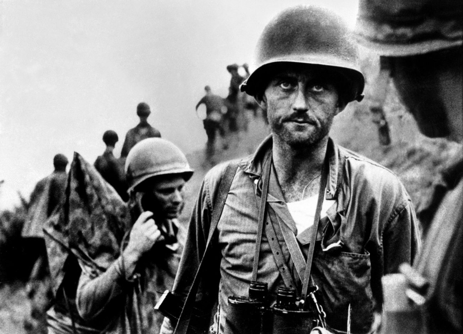 """Marine Capt. Francis """"Ike"""" Fenton ponders his fate and the fate of his men after being told that his company is nearly out of ammunition, Korea, 1950."""