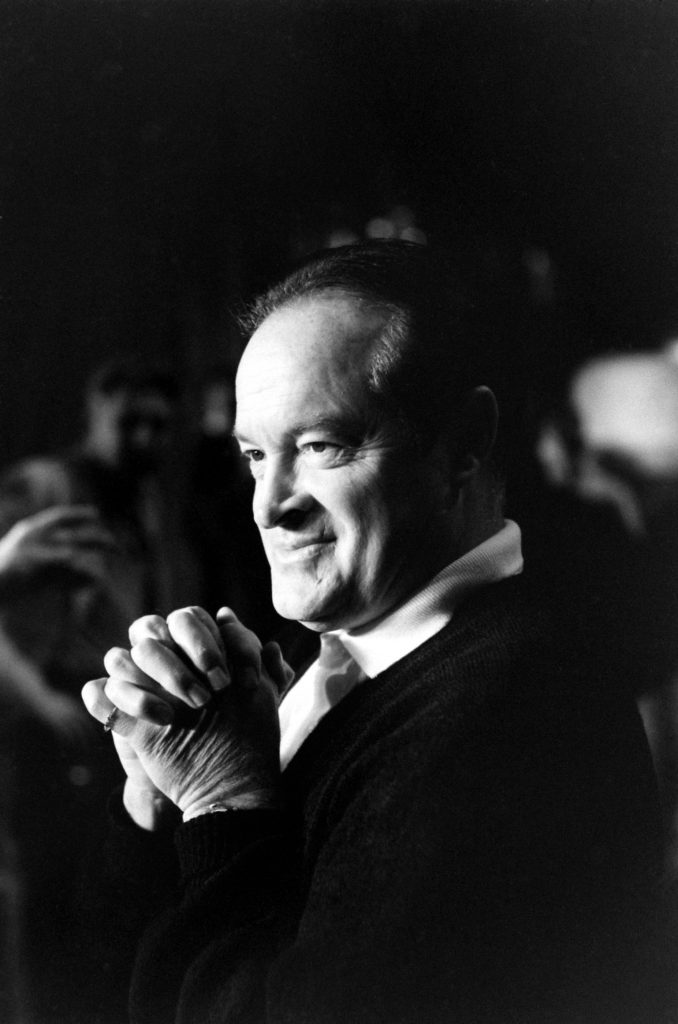 "Bob Hope, photographed in a quiet moment at the 1958 Oscar rehearsals. According to notes taken during Leonard McCombe's photo shoot, Hope cracked up the likes of Clark Gable and Cary Grant with new material: ""Tovarich Hope, newly returned from Moscow, unlimbers his Russian jokes."""