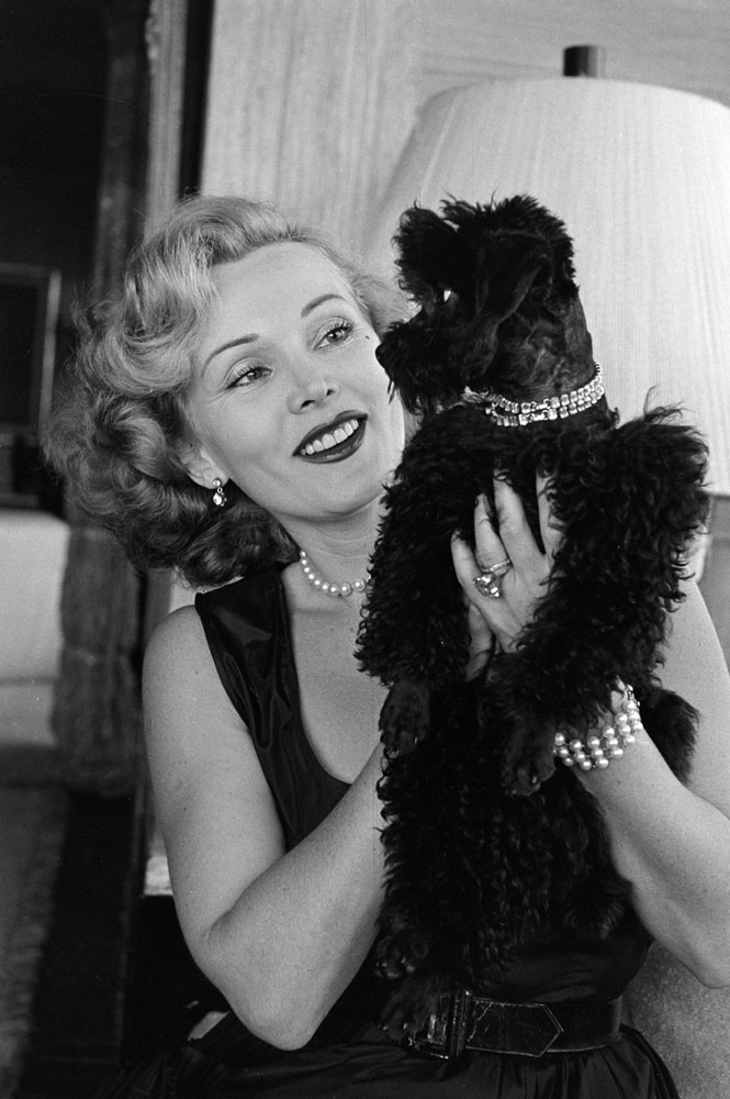 Zsa Zsa Gabor with her dog, Farouk, California, 1951.