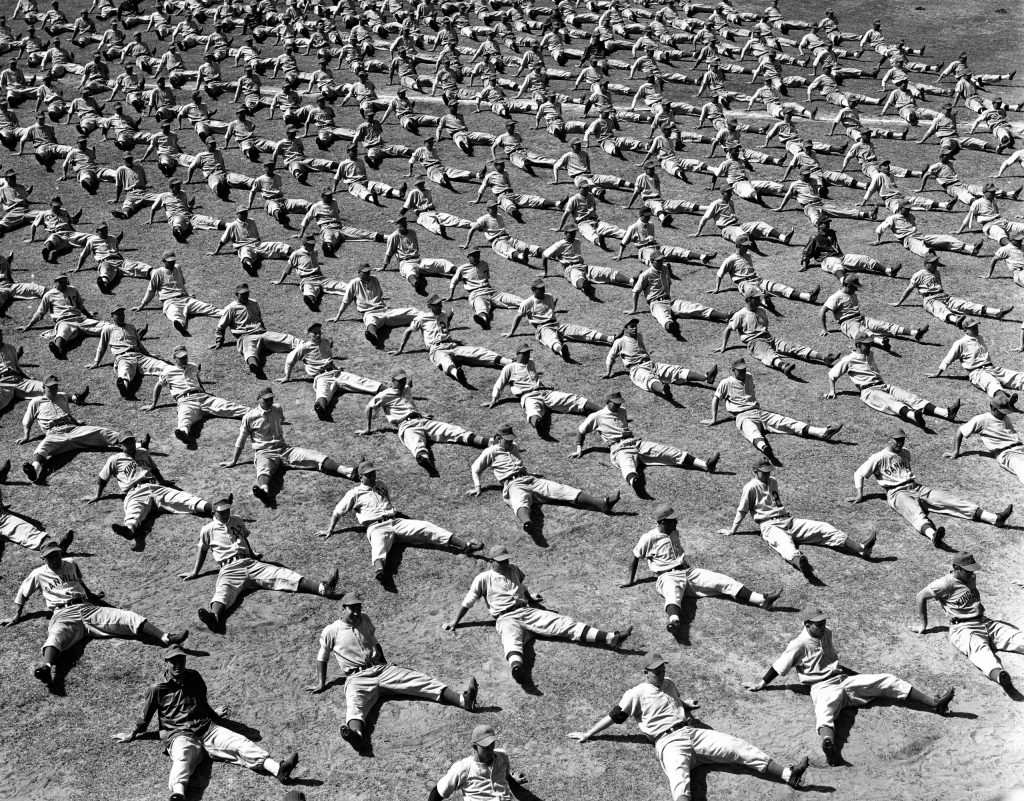 Brooklyn Dodger rookies and prospects do calisthenics as part of daily training routine, Vero Beach, Fla., 1948.