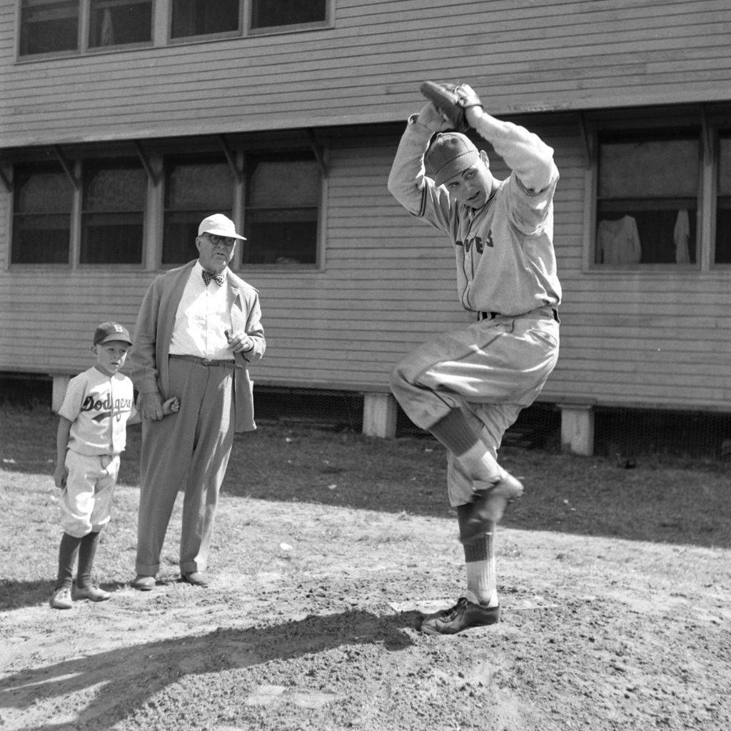 The great Dodgers general manager Branch Rickey and his grandson watch a pitcher go through his wind-up, Vero Beach, Fla., 1948.