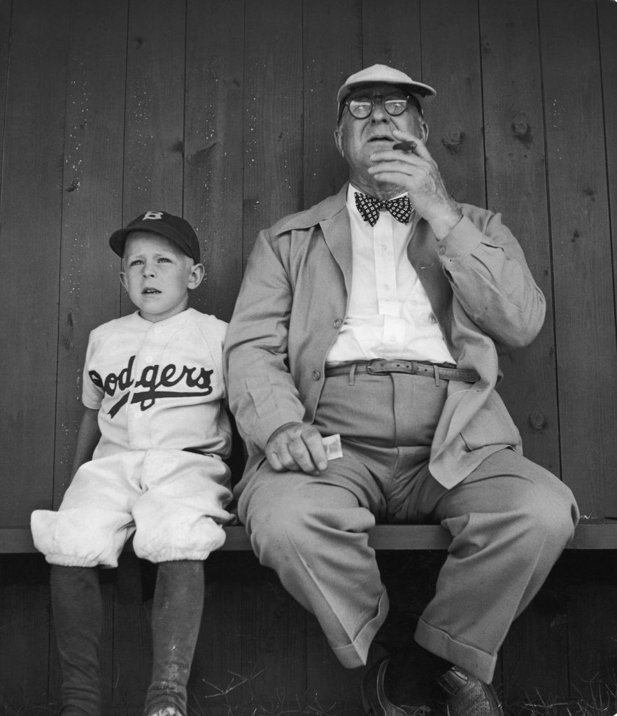 Branch Rickey watches practice with his grandson during spring training at Dodgertown, Vero Beach, Fla., 1948.