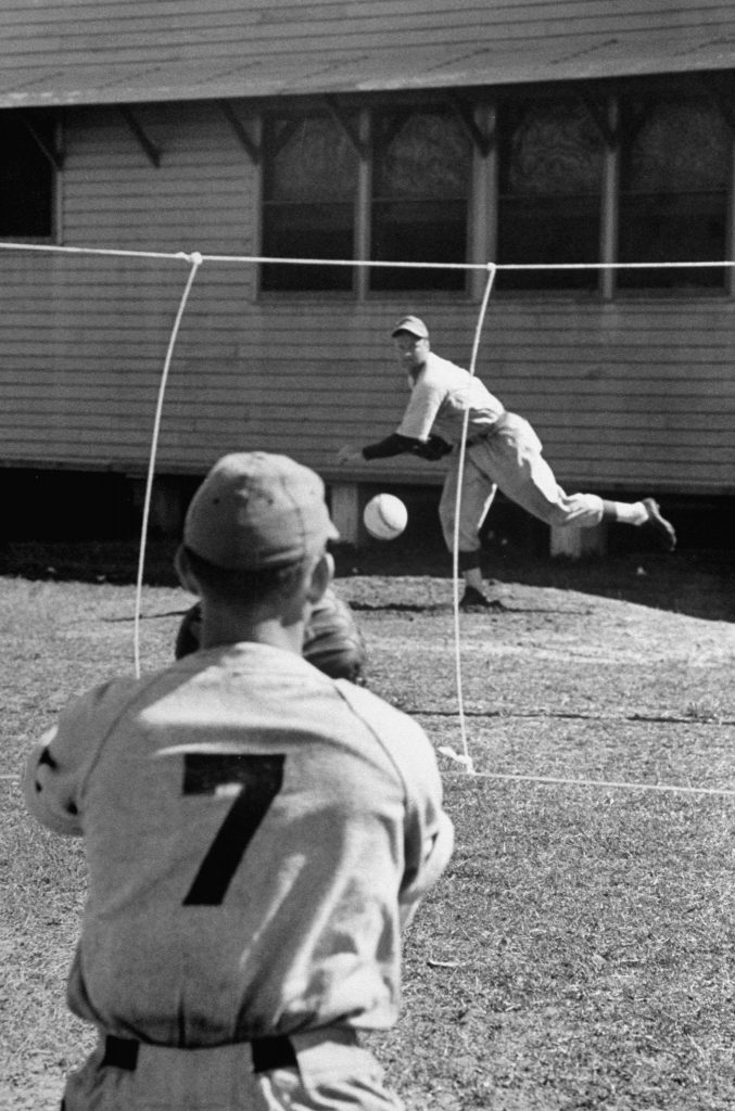 With strings marking the strike zone, a pitcher practices during spring training at Dodgertown, Vero Beach, Fla., 1948.