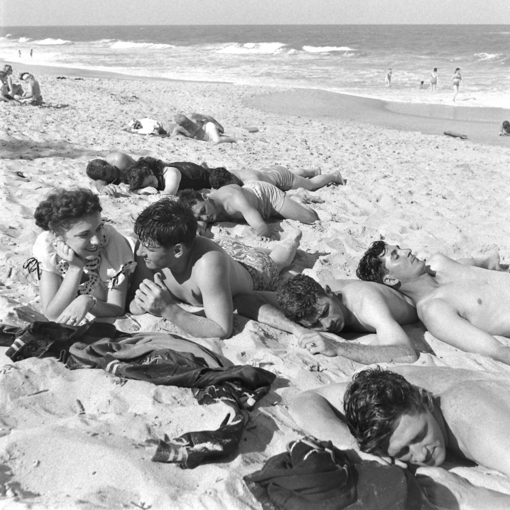 Brooklyn Dodgers and young women relax on the beach during spring training at Dodgertown, Vero Beach, Fla., 1948.