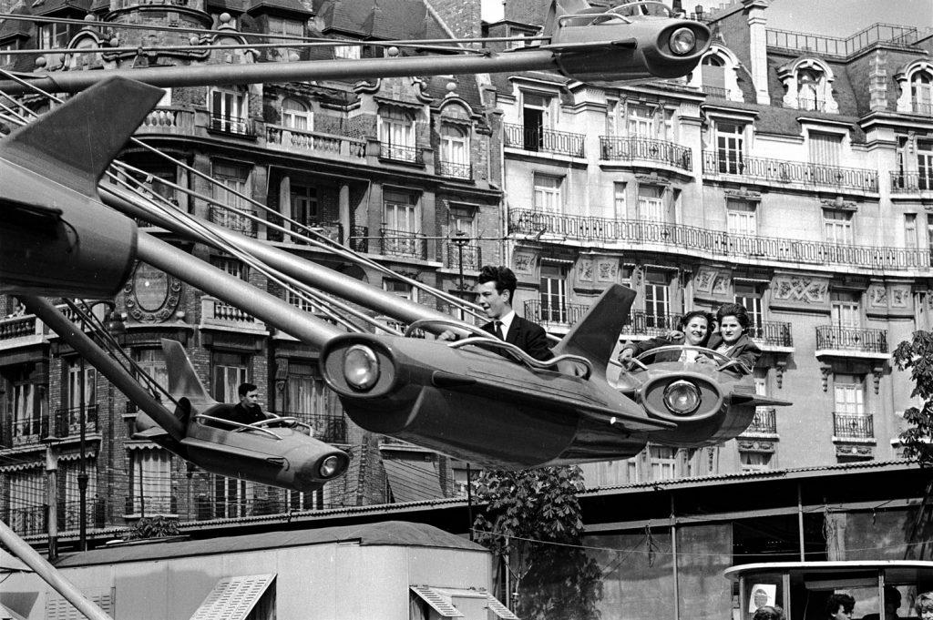 Parisians enjoying an amusement park ride, 1963.